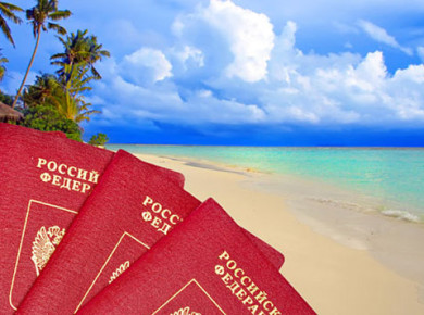International passports of Russia against a tropical beach